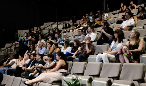 Audiences at Outfest participating in a Q&A about The Chunta